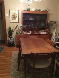 Solid Teak Wood Hutch with Glass Doors, Solid Teak Dining Room Table with Leaf and 6 chairs.