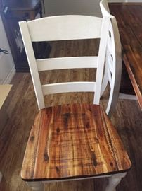 Dining room chairs with embossed seats and matching farmhouse table