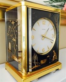 Fine and Rare, Jaeger-LeCoultre Vintage Atmos V Black Chinoise Turning Pendulum Clock, showing a Chinese landscape in a three-dimensional motive by artist Marina.  Simply Stunning! Has original box and brochure.  Collectors come running!