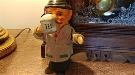 Hofbrau House figurine from Germany with moveable arm
