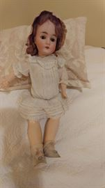 """Early 1900's Germany 24"""" bisque Queen Louise 7 1/2 doll.  Fully jointed, brown weighted eyes, open mouth with teeth.  Original light brown hair, crochet cap, lace undergarments, lace socks, light gray shoes"""