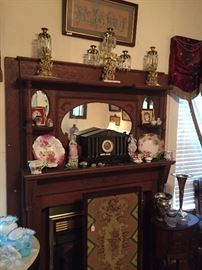 A view of the living room showing a stunning three-piece gilt and marble Girandole set dating about 1850,  with fine glass drops. Below is an antique black slate and ormolu  mantel clock & an Empire mahogany and needlepoint fire screen.