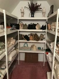 PACKED closet full of purses, linens, pillows...