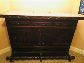 Carved wooden bar with marble top