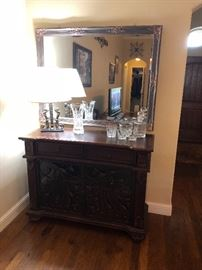 Howard Miller wine cabinet with large mirror above