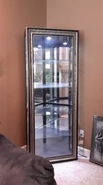 Stunning corner lighted glass curio with sliding front!
