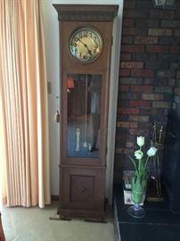Antique tall clock in beautiful oak case   Mission