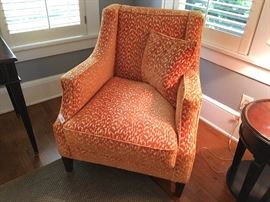 Arm chair upholstered in orange velvet with tan accents