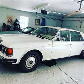 1991 Silver Spur Rolls Royce $20,000 - top of car has a few issues.  Probably needs upholstery work for the soft top - hence the price.  91,000