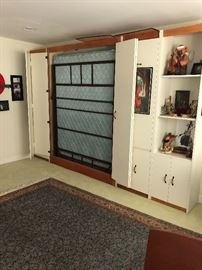 White queen size Murphy bed - mattress is upgraded - attaches to wall - panel to the right is a desk. $1000 - must have licensed person remove,  Please call me if you would like this item earlier.