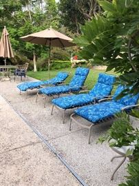 Patio table chairs with umbrella and lounge chairs