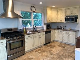 kitchen cabinets with granite countertops.