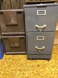 Two drawer file cabinets. One metal. One sturdy plastic.  Both are letter size.