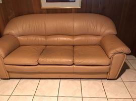 Tan leather comfortable sofa.