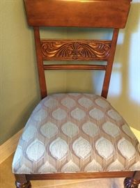 Carved chair with custom upholstery