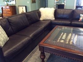 West Elm dark brown leather sectional. Measures 8' x 11'