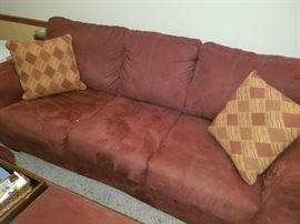 Microfiber suede Rust/Brown Sofa is just wonderful. It also has a unique large bench/coffee table/ottoman that can be purchased to go with it!