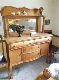 This is a dynamic Antique piece with hoof feet and mirror in good condition.