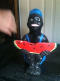 "Vintage Black Americana lawn jockey statue with watermelon; approx. 12 "" high"