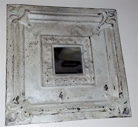 metal ceiling tile made into mirror