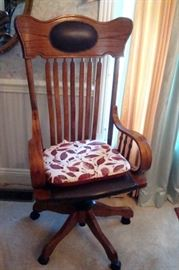 Antique oak desk chair.