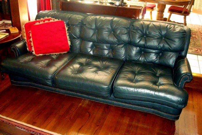 Green leather sofa.