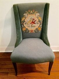 Needlepoint chair!  The entire chair is needlepoint  except the arms which are blue velvet.