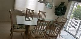 Glass-top dining set seats 6