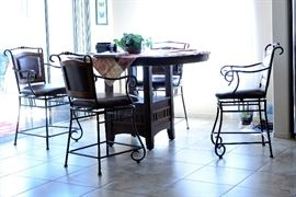 Wrought iron dining table and chairs.