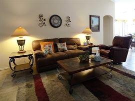 SOFA IS ELECTRIC POWERED RECLINER AND LOOKS SHOWROOM NEW!!! Lazyboy chair, rug, tables, lamps, pillows, wall art all in beautiful condition. The furnishings look new.