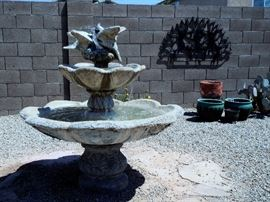 Beautiful large cement fountain and more garden art and pots.