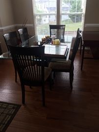 Glass top table with 6 chairs like new