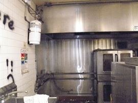 16 foot Stainless steel exhaust hood, (2 8 foot sections,  Stainless steel back wall and fire suppression system...roof mounted powered vent********$1800******* You Remove.  Call Now!! (760) 445-8571    (760) 975-5483
