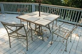Outdoor tiled top table with six chairs, cushions (not shown) are also included