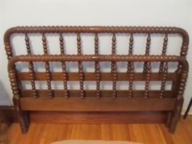 One of 2 full size Jenny Lind beds