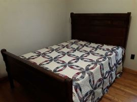 Antique bed, and double wedding ring quilt