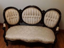 Victorian sofa, white with arms and three upholstered  circular features in back excellent condition