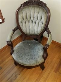 Green Victorian Chair very ornate and in great condition, one flaw noted is the spot in the center of the seat, very small
