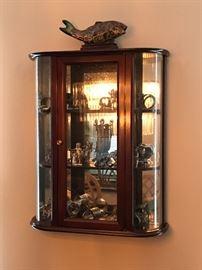 Nice wall curio cabinet