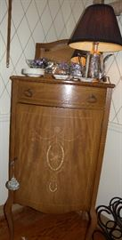 Music cabinet with shelves; convex front.