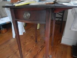 Vintage side table in cherry wood.