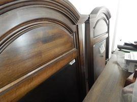 Pair of dresser mirrors that match a nice wooden dresser.