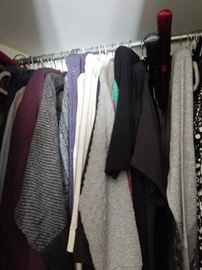 Closets full of women's clothing.