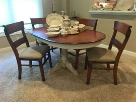 Round solid wood Canadel (made in Canada) Dining set table,  4 chairs, table shown with 2 leaves.