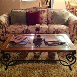 Heavy Wrought Iron, glass, & wood cocktail table, and another sofa.  We have a matching end table.