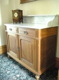 Marble Top Wash Stand and 1 of many old Mantle Clocks.