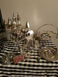 Nice selection of sterling silver serving items and a sampling of sterling jewelry