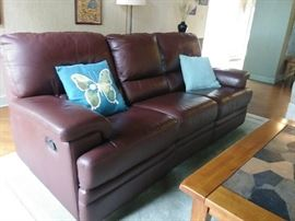 Leather sofa with side reclining feature