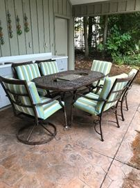Patio dining table with six chairs. 2 chairs swivel.