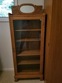Antique glass front cabinet